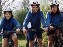 Guides on mountain bikes. Picture credit: Girlguiding UK