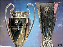 The Champions League and Uefa Cup trophies
