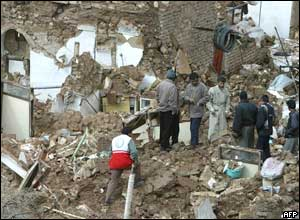 Villagers and rescuers search the rubble in the village of  village of Dahuyeh