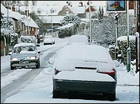 Cars in Kent drive carefully through the snow