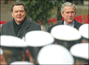 President Bush and Chancellor Schroeder review the guard of honour at the Electors Palace in Mainz