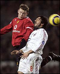 Wayne Rooney is challenged by Gennaro Gattuso