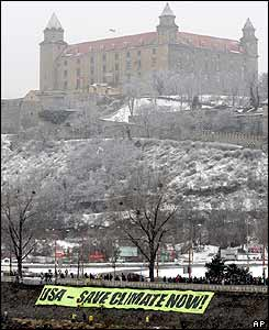 Greenpeace activists display a banner near the Bratislava Castle