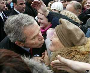 President Bush kisses a Slovak woman from the crowd