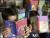 Kids reading Harry Potter