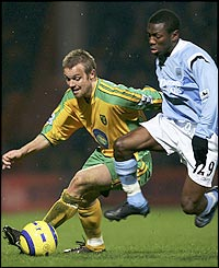Shaun Wright-Phillips (R) tussles with Mattias Jonson