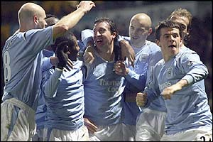 Man City's players celebrate Fowler's winner