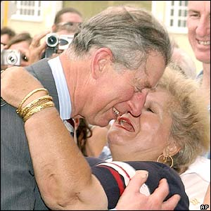 Prince Charles is hugged and kissed by Esperance Vanderham