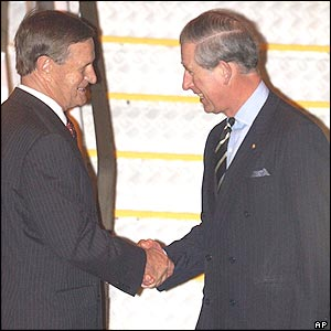 Prince Charles is greeted by state governor John Sanderson