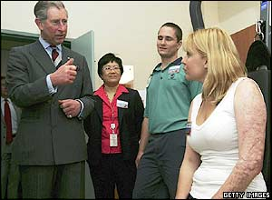 Prince Charles and Melinda Kemp in the rehabilitation room