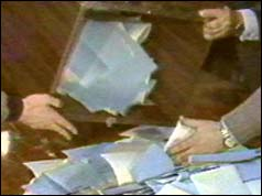 Officials empty ballot boxes in Soviet election