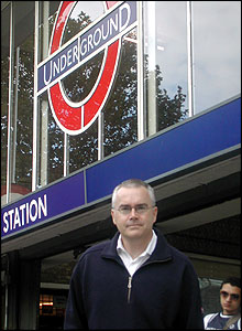 Newsreader Huw Edwards at White City Underground station.