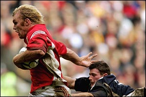 The South's Schalk Burger shakes off Andy Titterrell