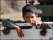 Child in India waiting for aid