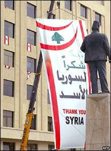 A banner reading 'Thank you Syria' is put up ahead of a rally in Beirut