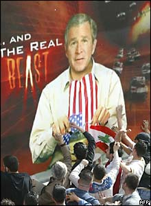 Demonstrators in Beirut stab a poster of US President George W Bush