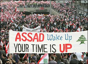 Opposition demonstrators carry a banner urging Syria's president to leave