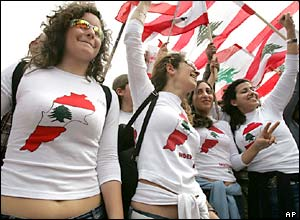 Female Lebanese opposition protesters wear sweatshirts showing a map of Lebanon
