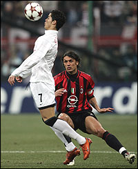 Ronaldo heads the ball away from Paolo Maldini