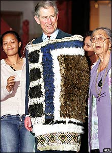 Prince Charles posing with a Kiwi feather cloak and grass skirt