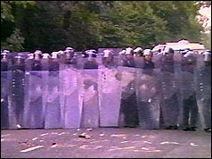 Police officers holding riot shields