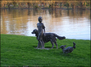 Statue of girl with dogs, Chiswick mall, London