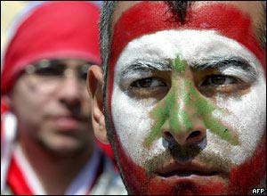 Protester with Lebanese flag painted on his face