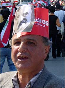 Lebanese anti-Syrian protester wears hat made from picture of Hariri