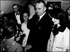 Lyndon Johnson is sworn in as Jacqui Kennedy looks on
