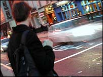 A pedestrian crossing a road in London