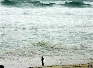A walker watches the sea in Cancun Mexico. Hurricane Wilma was the strongest ever to from in the Americas.