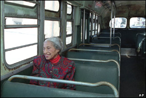 Rosa Parks poses for pictures back on the bus in 1995.