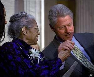 Rosa Parks is given the Congressional Gold Medal in 1999 by the then President Bill Clinton