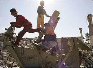 Iraqi children playing on an old gun