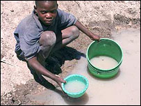 Boy collecting water in Tanzania (courtesy of WaterAid)