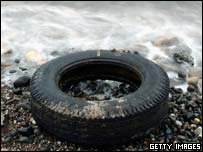 A tyres is washed up by the sea on the beaches in Prestwick, Scotland