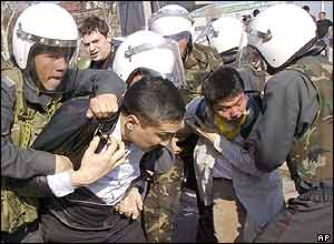 Kyrgyz policemen arrest opposition supporters in downtown Bishkek, Kyrgyzstan, Wednesday, March 23, 2005.