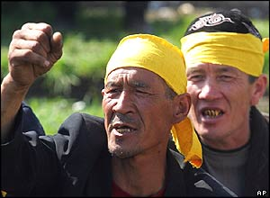 Kyrgyz protesters shout anti-government slogans at the central square in Osh, Kyrgyzstan's second-largest city, Tuesday, March 22, 2005
