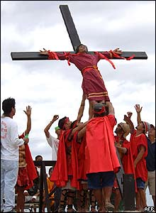 A man is pulled down after being nailed to a cross during a Good Friday ritual in the Philippines