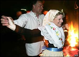A couple in traditional clothes dance around an Easter fire 27 March 2005 in Luebbenau, eastern Germany