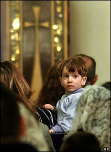 An Iraqi boy looks about during Easter services at the Virgin Mary Church in Baghdad, Iraq