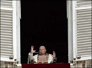 Pope John Paul II blesses the crowds at the Vatican from his window