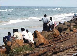 Sri Lankans look out to sea following the Indonesian earthquake