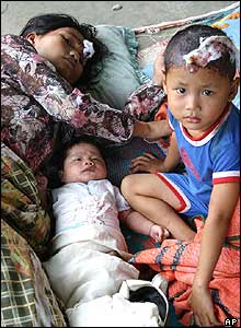 A mother with her two young children at a temporary shelter in Nias