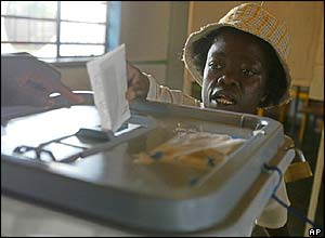 Woman votes at a polling booth in Harare