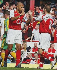 Thierry Henry celebrates with fellow scorer Freddie Ljungberg