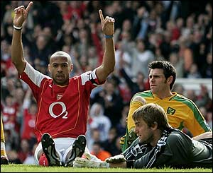 Thierry henry celebrates his hat-trick