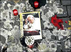 Picture of the Pope amid remembrance candles