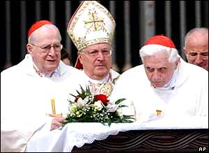 Vatican Secretary of State Angelo Sodano, flanked by German Cardinal Joseph Ratzinger (R) and Cardinal Giacomo Biffi