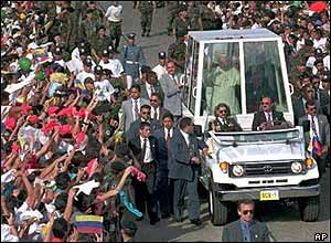 The Pope travelling in his Popemobile